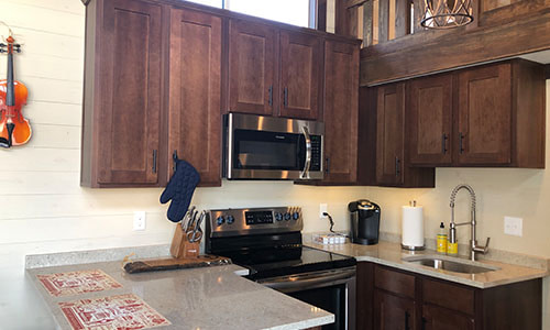 quartz counter top kitchen in a tiny house