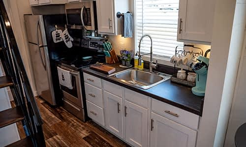 full kitchen in a tiny house for rent in tennessee