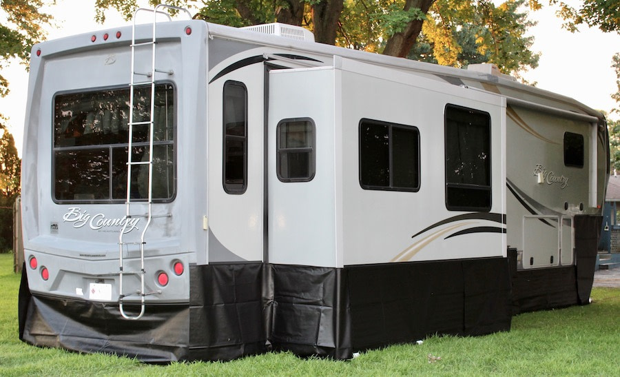 camper with rv skirting installed