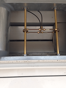 Portions of airflow sensor ports installed above the air path into the rooftop air handling unit