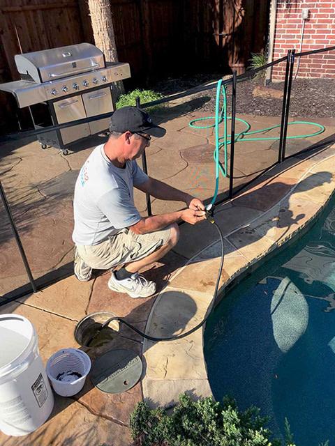 Pool Leak specialist fixing a pool-spa leak